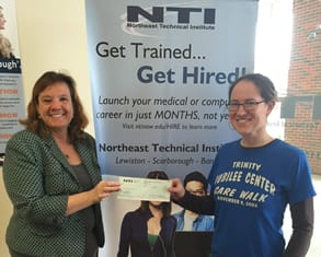 Keri Robichaud of NTI presents $1000 donation to Erin Reed, Executive Director, Trinity Jubilee Center