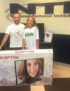 "Rick Leslie and daughter win this years Summerfest raffle - a 50"" Smart TV"