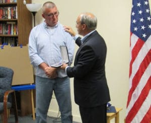 Congressman Bruce Poliquin Presents the Purple Heart to  Northeast Technical Institute's Mike Francis Purple Heart recipient Sgt. Michael Francis (left) with Congressman Poliquin at Friday's ceremony.
