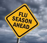 Street sign that says flu season ahead.