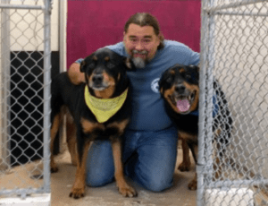 "Robert Haley, or ""Roadhouse Lou"" in a kennel with two dog pals."